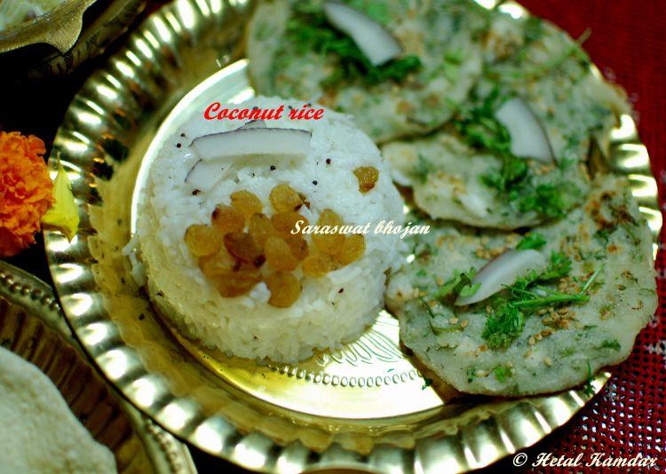 Saraswat Bhojan, coconut rice garnished with raisins and buttermilk pancakes
