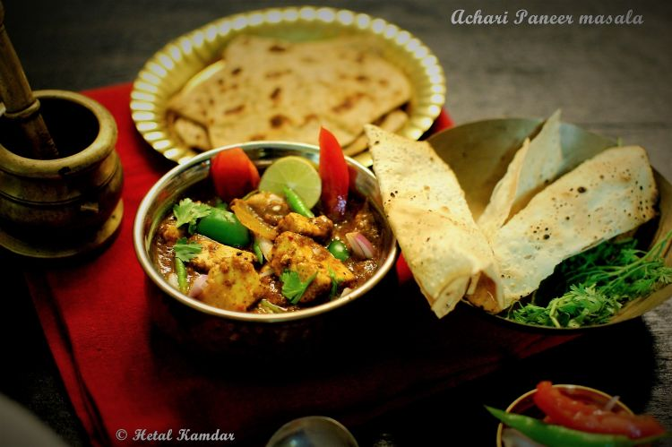 achari paneer masala recipe served with parathas, papads and salad