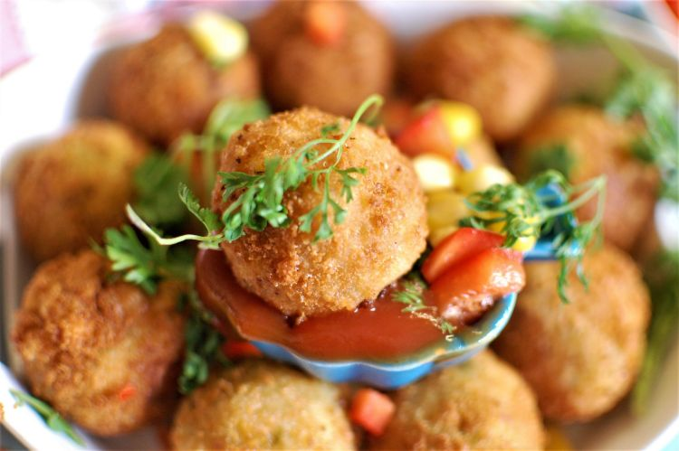 Corn Cheese Balls served with tomato ketchup and garnished with coriander leaves