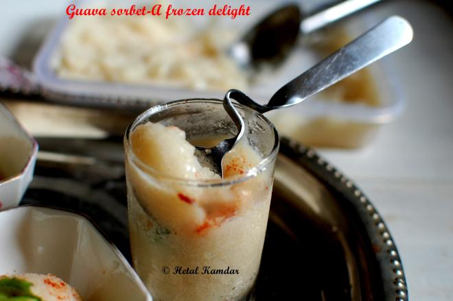 how to make guava sorbet, Italian sherbet, close up view of guava sorbet served in a glass along with a spoon