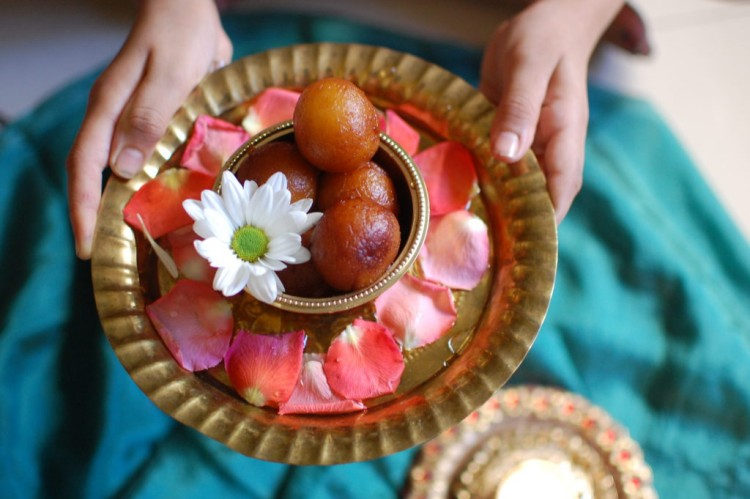 Gulab Jamun Recipe | Gulab Jamun ready to serve on a brass plate decorated with fresh flowers