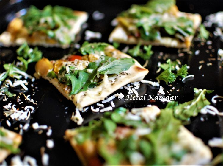 Healthy vegetarian tawa Pizza with Rocket Leaves