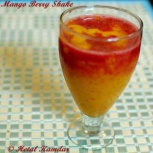 close up photo of mango, strawberry milkshake served in a glass , how to make mango berry shake