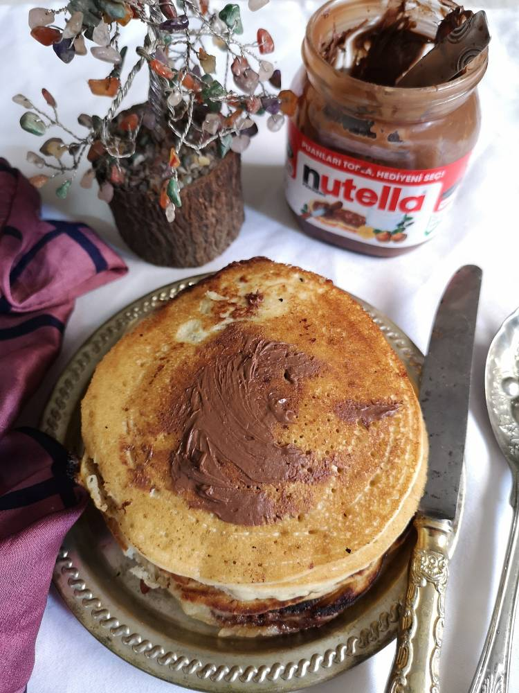 Delicious Nutella Pancakes with Nutella spread on top of it
