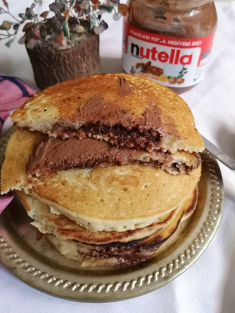 Nutella oozing out from pancakes when cut into half , stack of nutella pancakes recipe