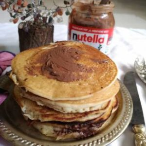 Stacks of Nutella Pancakes stuffed with Nutella discs