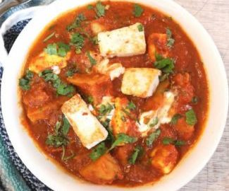 aloo paneer recipe , aloo paneer served in a white bowl with white board and a blue napkin