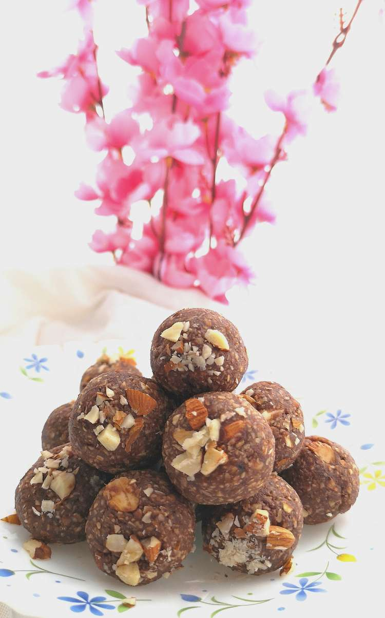 close up view of Brownie Energy Bites topped with crushed almonds ready to be served