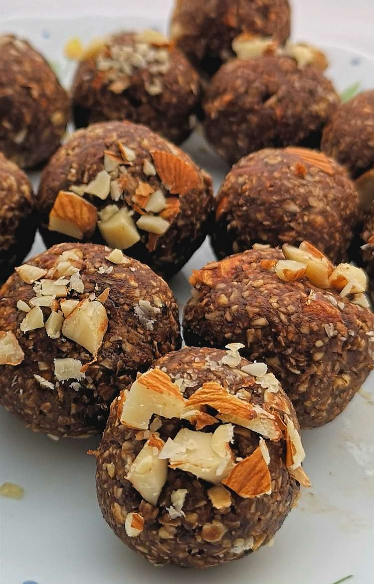 close up view of Brownie Energy Bites topped with crushed roasted almond