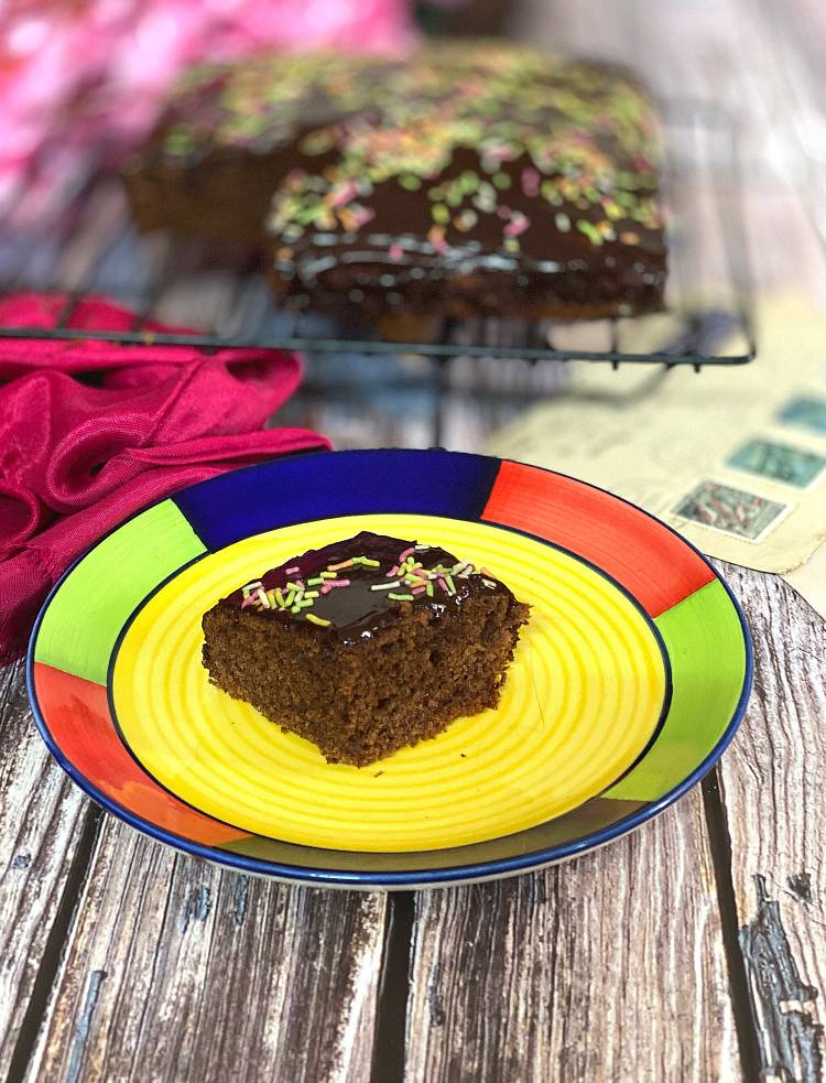 close up photo of a cut slice of chocolate Ragi Cake, ready to be eaten, how to make Chocolate Ragi Cake, Recipe of healthy Nachni Chocolate Cake