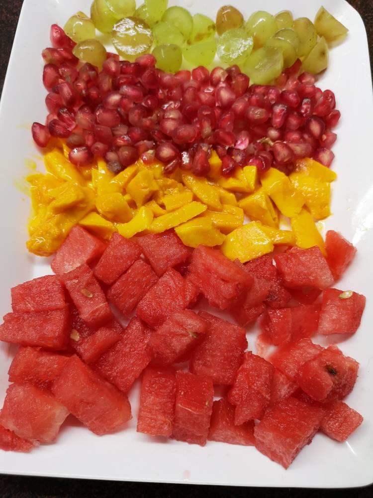 chopped fresh fruits arrange in a plate for fruit cream recipe