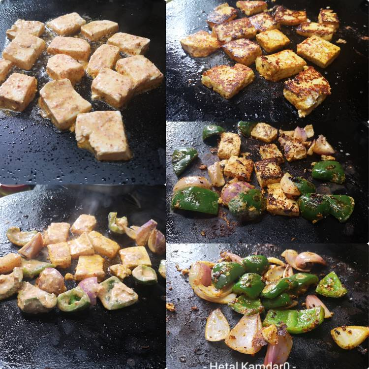 grilling or roasting marinated paneer, onion and capsicum on a hot griddle for preparing paneer tikka masala recipe