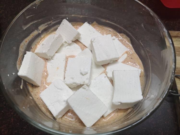 Marinating Paneer cubes in spiced hung yogurt for Tawa Paneer Masala
