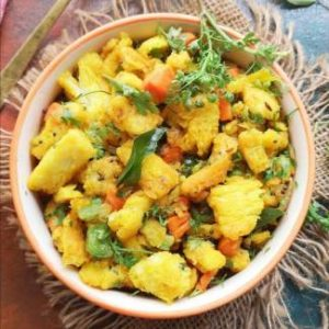 Close up view of bread upma recipe garnished with fresh coriander leaves