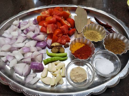 onion, tomato, garlic, ginger, green chili and spices for chole recipe