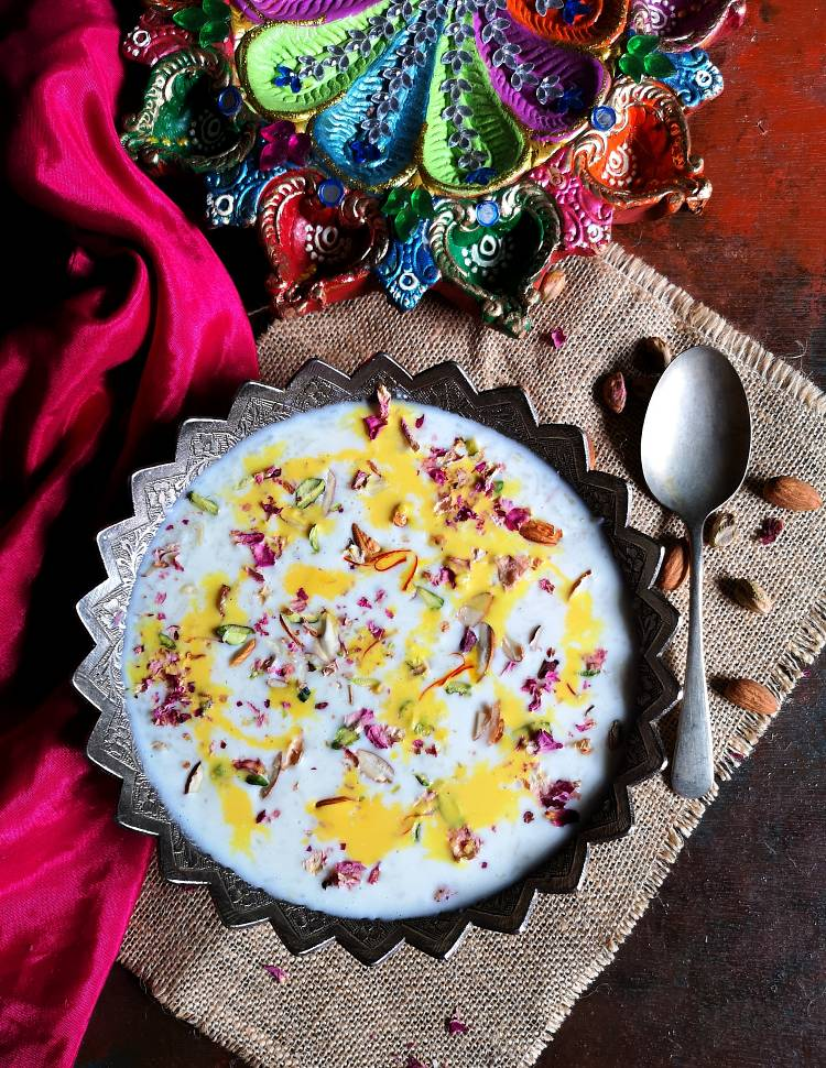 doodh pak recipe, doodh pak served in a silver bowl garnished with almonds, pistachios and kesar milk