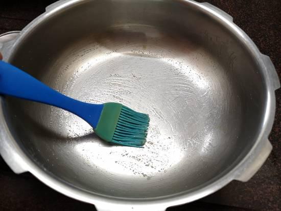 greasing pan with ghee
