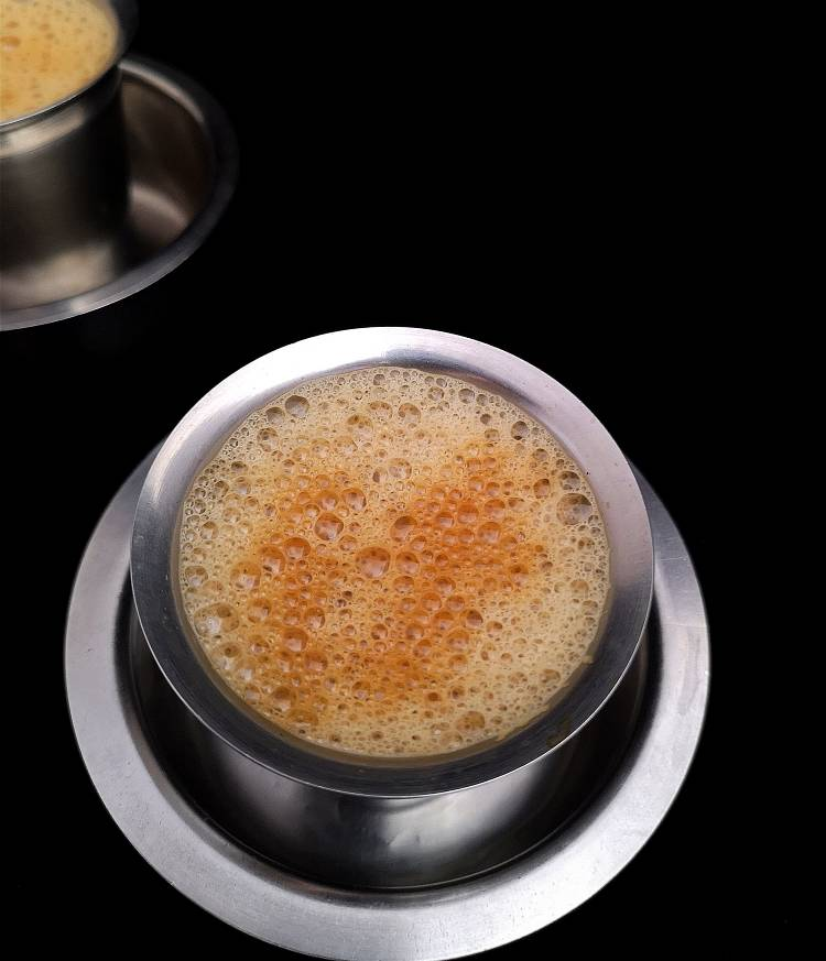 how to make South Indian Filter coffee recipe at home, close up view of strong, frothy filter coffee served in steel tumbler