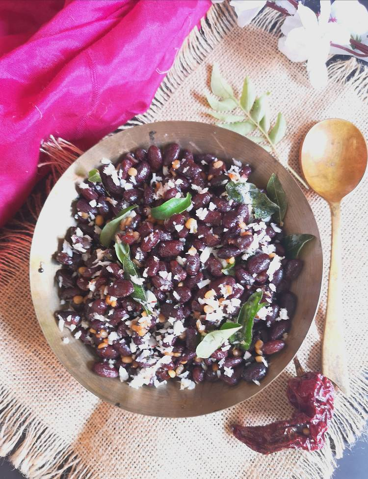 Close up view of Rajma Sundal garnished with freshly grated coconut and curry leaves