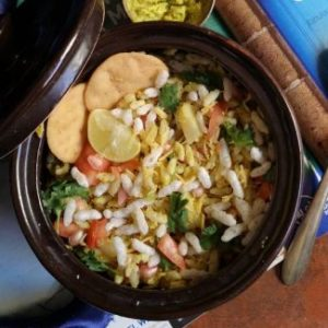close up view of lip smacking sukha bhel served with papdis and sev