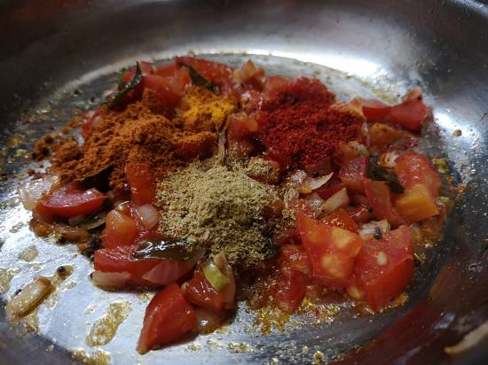 adding spices to tomato rice recipe