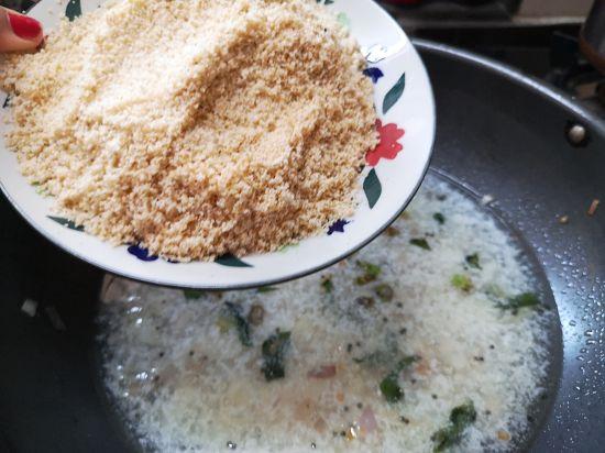adding roasted rava to upma recipe
