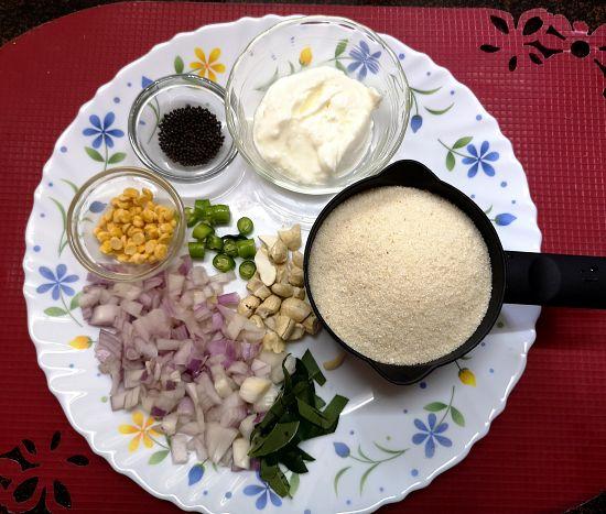 Rava/ Semolina, onions, cashew nuts, onion, curd, chana dal and mustard seeds for making Upma Recipe