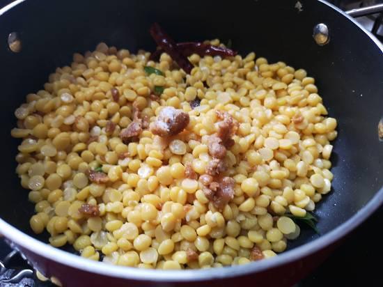 adding jaggery in chana dal sundal recipe