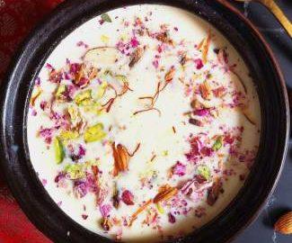 Close up view of Channar Payesh, Kesar paneer kheer loaded with almonds, pistas, kesar and rose petals, how to make kesar paneer kheer