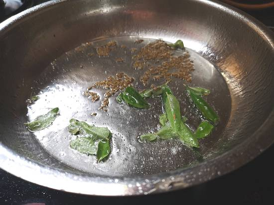 do tadka of jeera and curry leaves for pumpkin sabzi