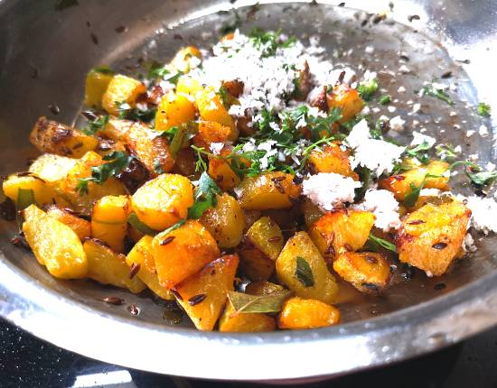 garnish with coconut and coriander leaves for pumpkin vegetable