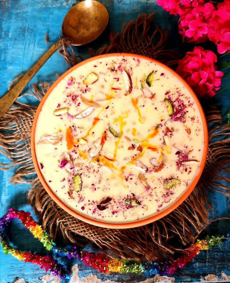 close up view of sabudana kheer garnished with dry fruits and rose petals