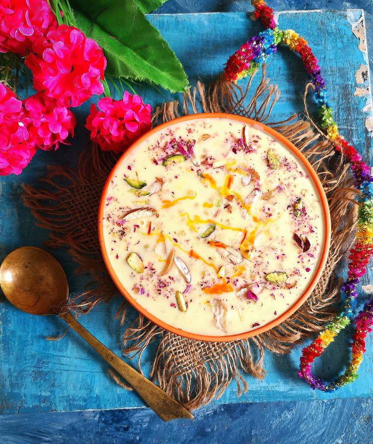 top view of sabudana kheer garnished with dry fruits and dry rose petals