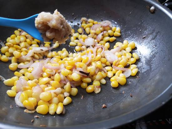 adding ginger garlic paste to sweet corn