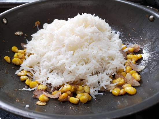 adding boiled rice to sweet corn rice recipe