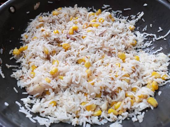 mixing it well forRecipe of Sweet Corn Pulao | How to make sweet corn rice