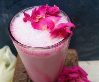 top view of delicious rose milkshake with rose petals, fasting rose milkshake recipe