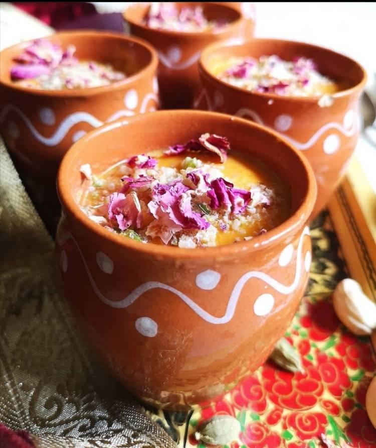 side close up view of Mango Matka Kulfi garnished with almonds, dry rose petals, How to Make Mango Matka Kulfi