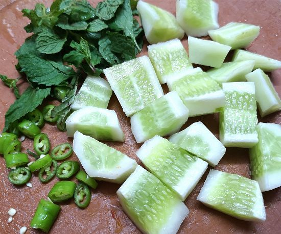 cut cucombers, chopped green chilies and mint leaves for cucumber watermelon salad