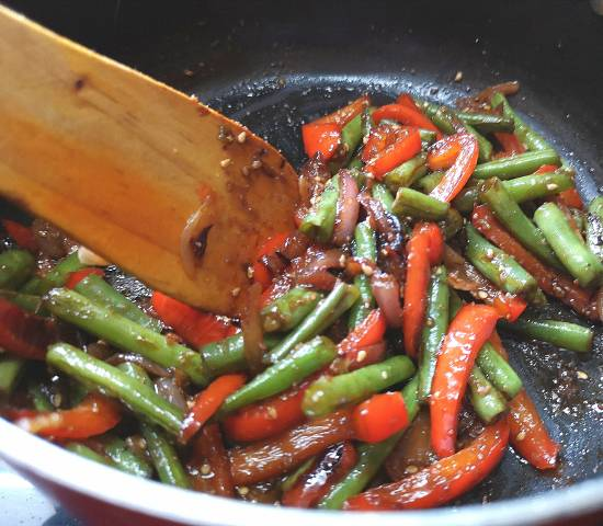 giving a quick stir after adding yasai salad sauce