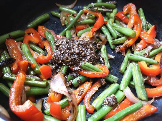 Mixing Yasai Salad Sauce into the cooked Vegetables