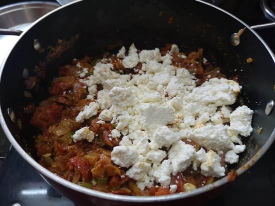 adding homemade crumbled paneer into the paneer bhurjee sabzi